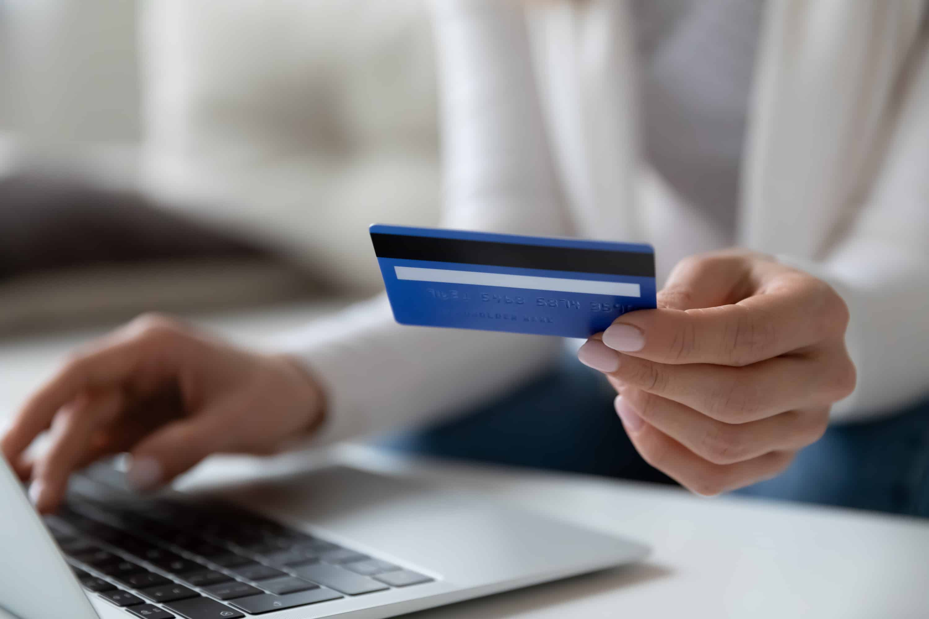 Woman entering credit card information to do a balance transfer