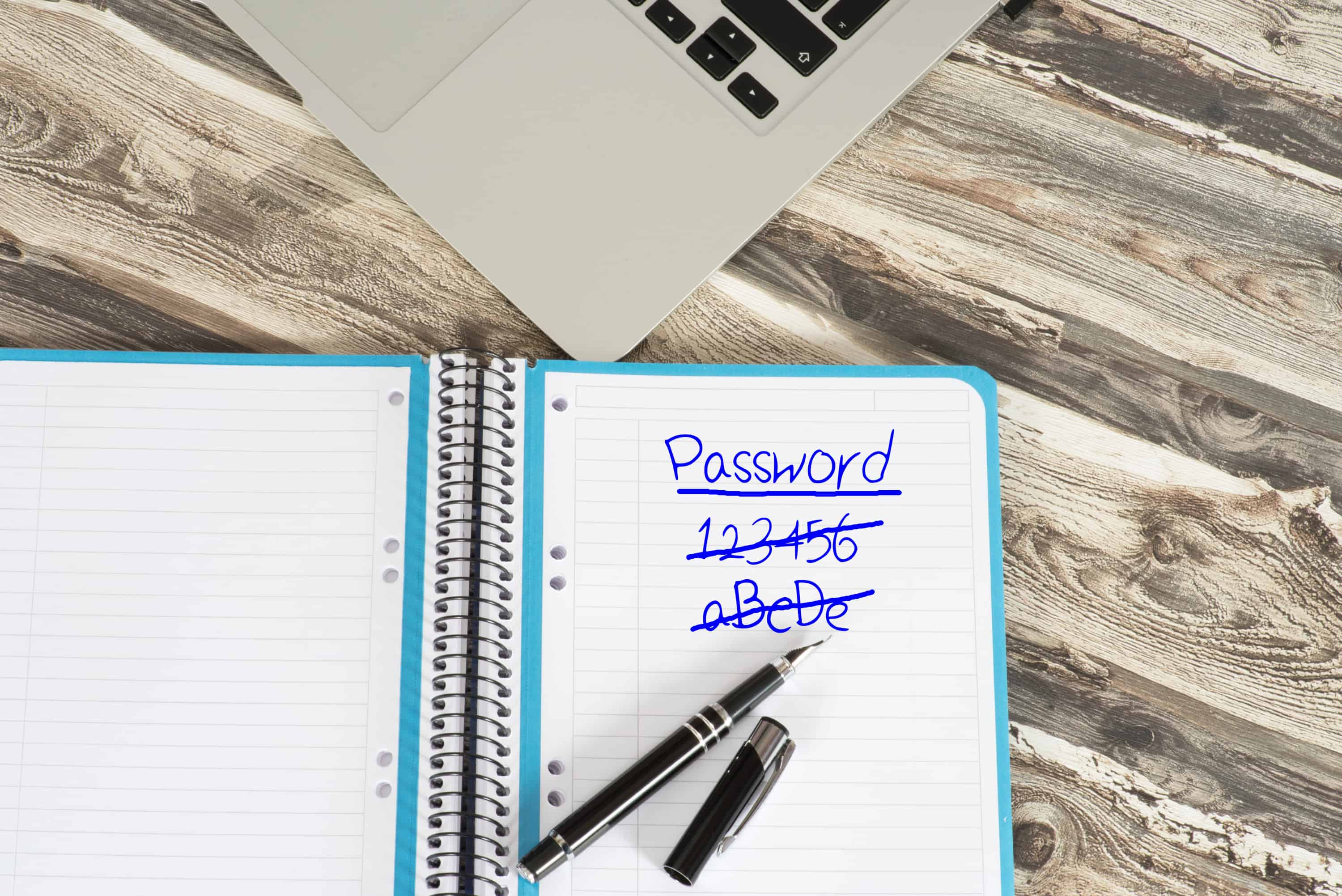 Passwords written and crossed out with a blue ink fountain pen in a notebook--could really use Lastpass password manager.
